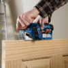 Planer is maneuverable for working on doors or hardwood